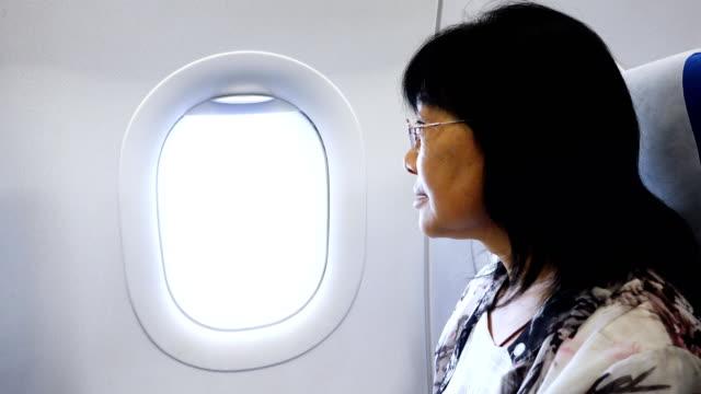 senior woman looking camera at airport