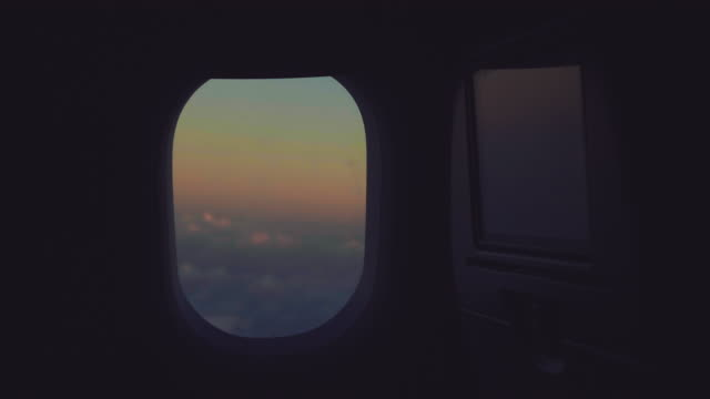 senior woman looking out window of airplane during flight - eyes closed stock videos & royalty-free footage