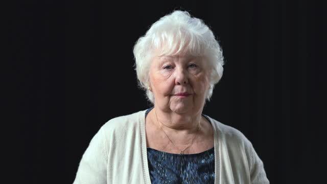 senior woman looking serious - headshot stock videos & royalty-free footage
