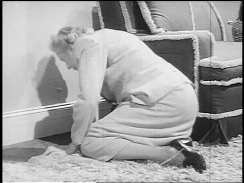 b/w 1951 senior woman lying balled up on floor in house covering face during nuclear explosion - yorkville illinois stock videos & royalty-free footage
