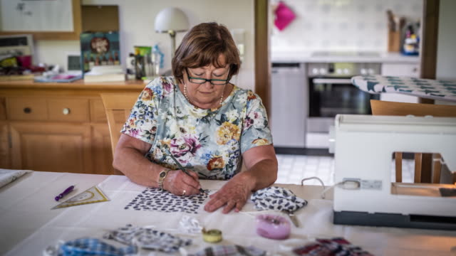 senior woman making anti-virus masks at home - sewing stock videos & royalty-free footage