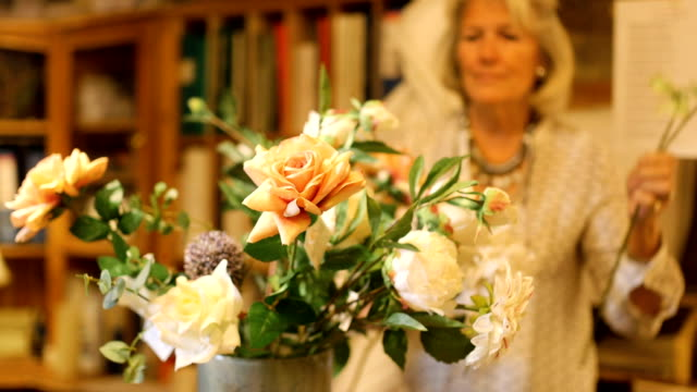 Senior Woman Making Bouquet of Flowers