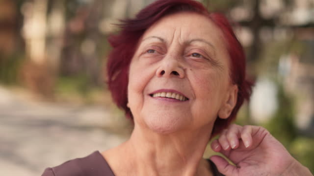 senior woman making sure to look beautiful for picture - femininity photos stock videos & royalty-free footage