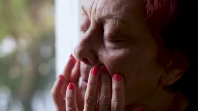 senior woman massage her face - headache stock videos & royalty-free footage