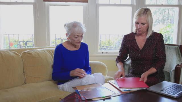MS Senior woman meeting with financial adviser at home / Portland, Oregon, USA