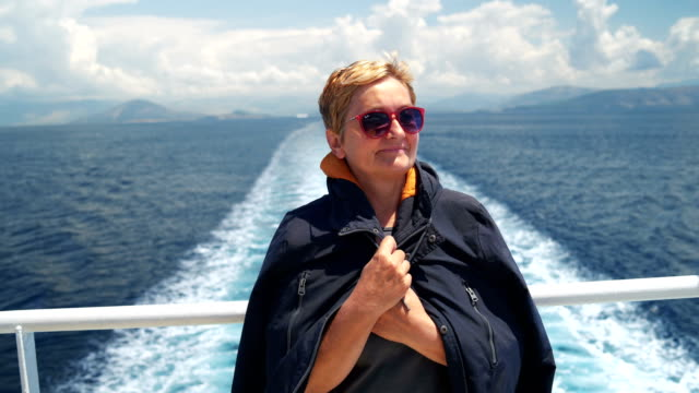 senior woman on a deck of a cruise ship - cruise stock videos and b-roll footage