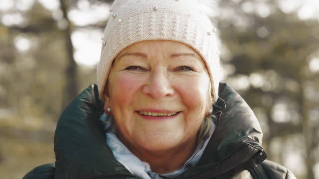 senior woman on a hike looking into camera - retirement stock videos & royalty-free footage