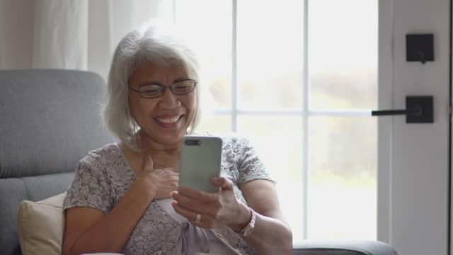 senior woman on a telemedicine video call - filipino ethnicity stock videos & royalty-free footage