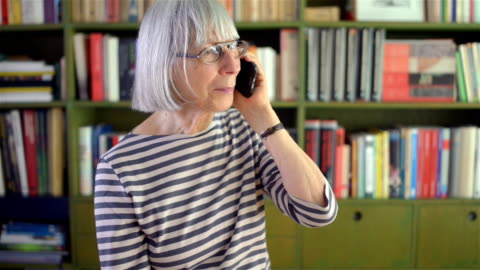 senior woman on the phone - one senior woman only stock videos & royalty-free footage