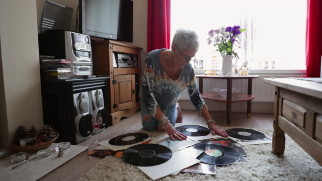 senior woman organising her record collection - collection stock videos & royalty-free footage