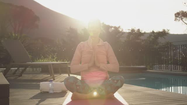 Senior woman outdoor yoga fitness