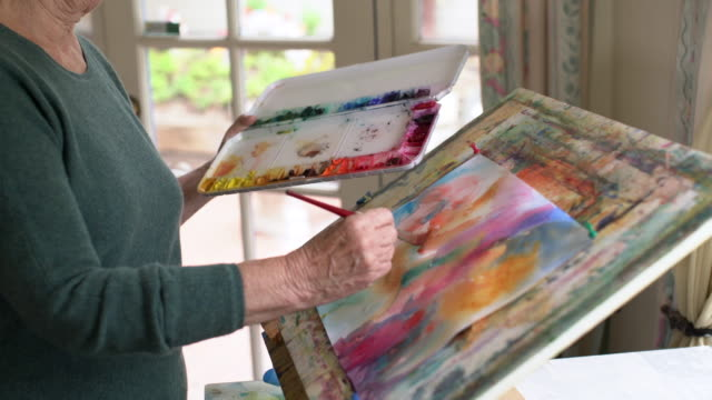ms cu senior woman painting in her studio - active seniors stock videos & royalty-free footage