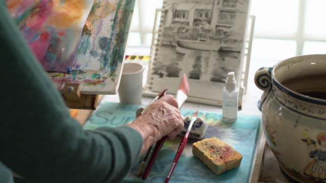 cu rv senior woman painting in her studio - hobbies stock videos & royalty-free footage
