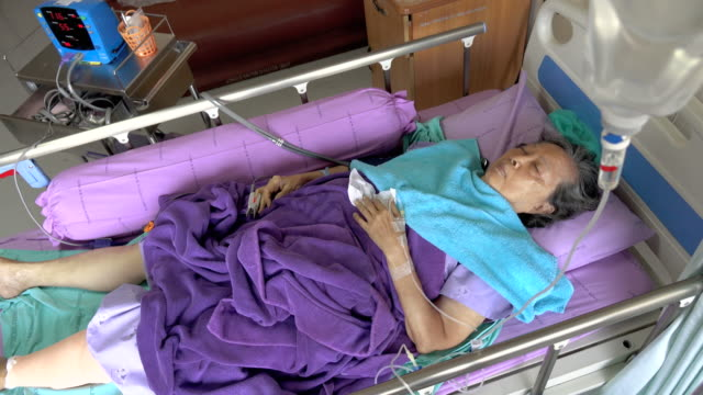 Senior woman patient in hospital bed