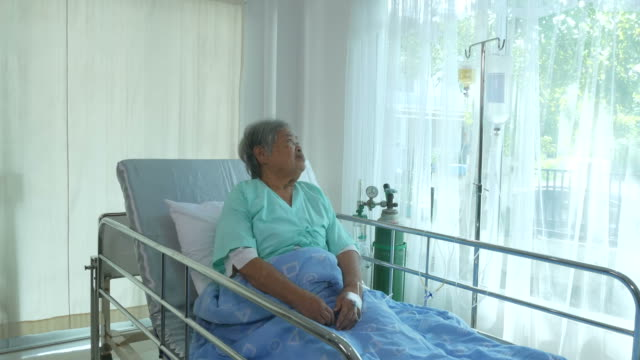 senior woman patient  sit on bed , feel depressed