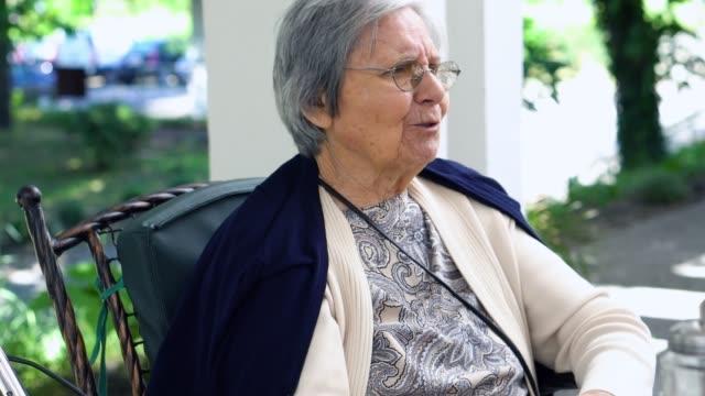 senior woman portrait outdoors - retirement community stock videos & royalty-free footage