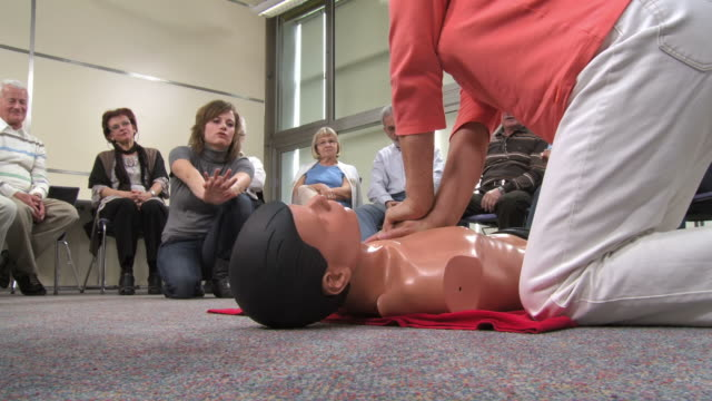 hd: senior woman practicing chest compressions - first aid kit stock videos & royalty-free footage