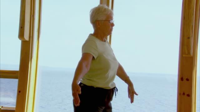 CU TU TD Senior woman practicing yoga, Halifax, Nova Scotia, Canada