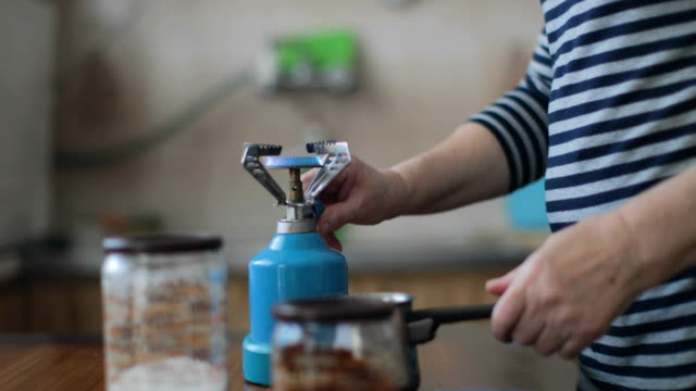 senior woman preparing a greek coffee - one senior woman only stock videos and b-roll footage