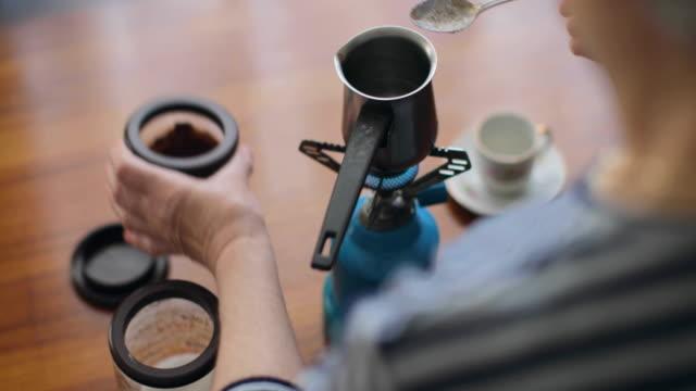 Senior woman preparing a greek coffee