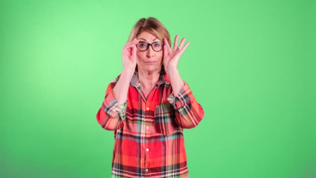 senior woman puts her glasses on - plaid shirt stock videos & royalty-free footage