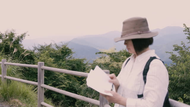 senior woman reading map at observatory in mountain - local landmark stock videos & royalty-free footage