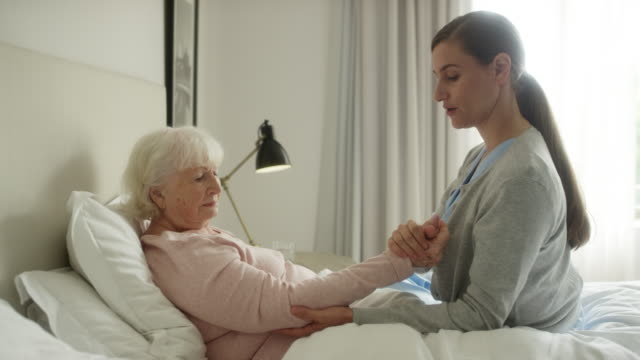 senior woman receiving physical therapy at home - trust stock videos & royalty-free footage