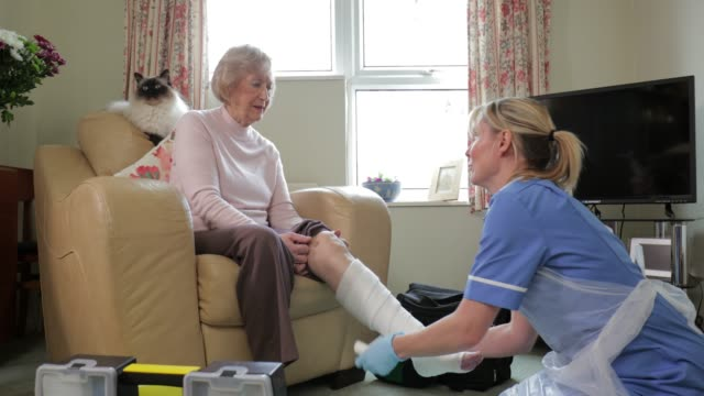 senior woman recuperating at home - sheltered housing stock videos & royalty-free footage