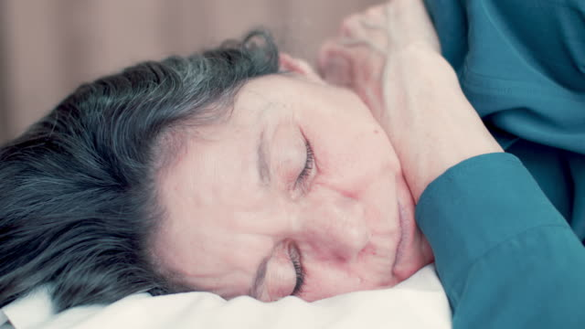 senior woman relaxing during treatment - massage table stock videos & royalty-free footage