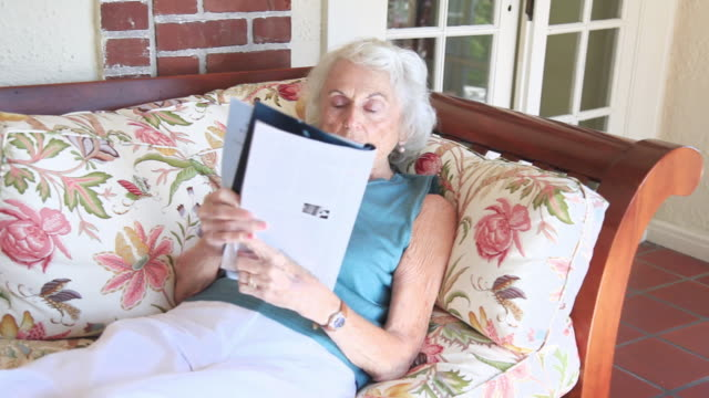 ms senior woman relaxing in sun-room at home / portland, oregon, usa  - portland oregon点の映像素材/bロール