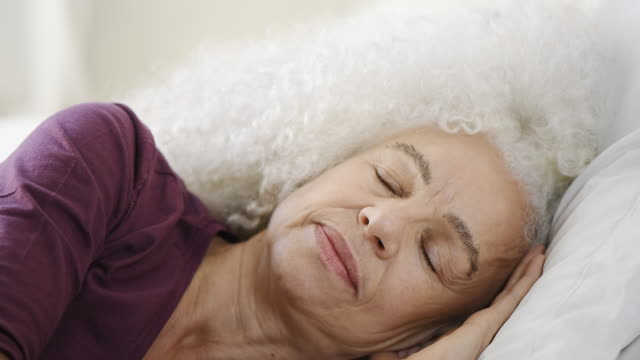 senior woman resting in bed