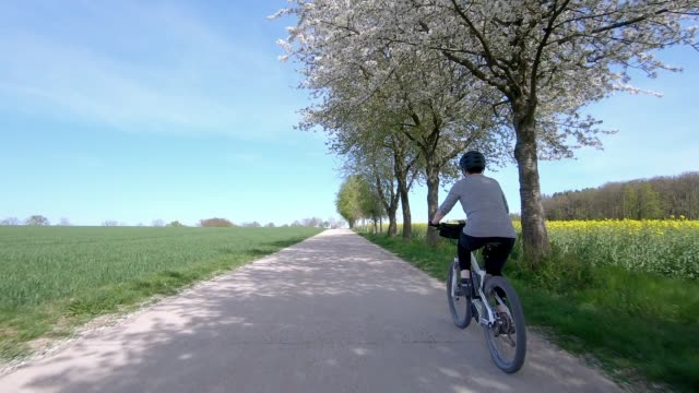 senior woman riding electric mountain bike - one mature woman only stock videos & royalty-free footage