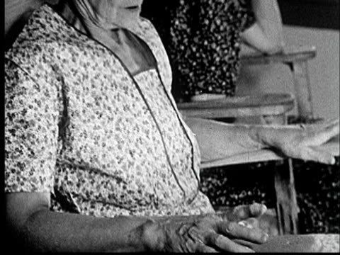 1953 CU Senior woman rocking in rocking chair/  TD Woman tapping finger on arm rest and tapping feet on floor/ Norman, Oklahoma