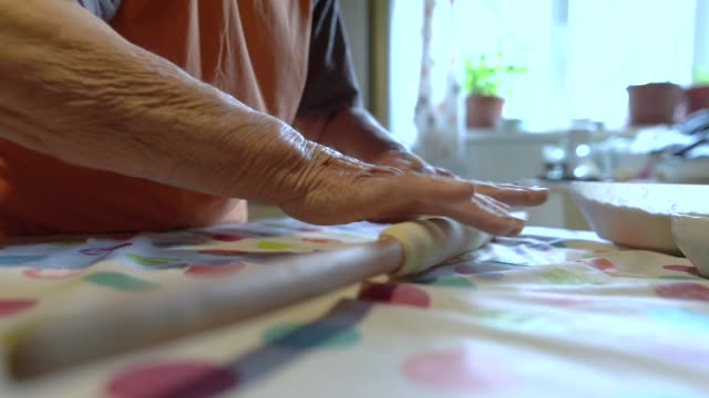 senior woman rolling pastry dough at her home - rolling pin stock videos & royalty-free footage