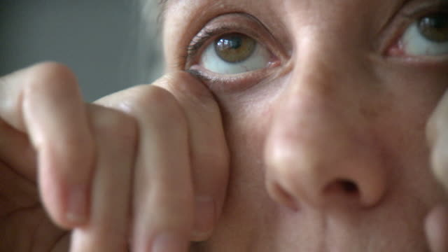 ecu senior woman rubbing eyes, new york city, new york, usa - strofinare toccare video stock e b–roll