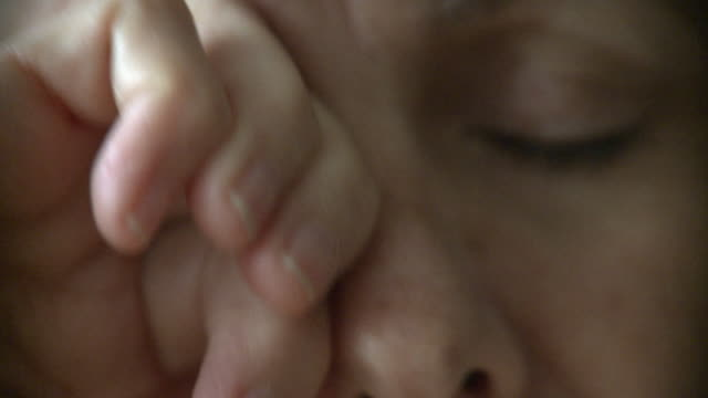 stockvideo's en b-roll-footage met ecu senior woman rubbing eyes, new york city, new york, usa - moe
