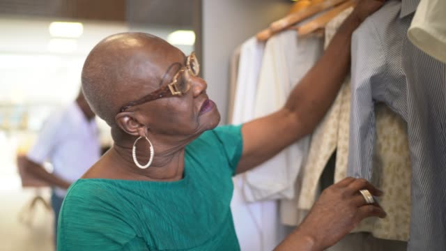 senior woman selecting clothes at home - choice stock videos & royalty-free footage