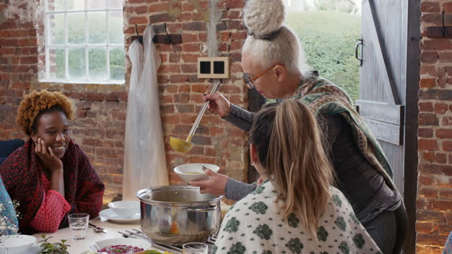 senior woman serving soup in cafe - kent england stock videos & royalty-free footage