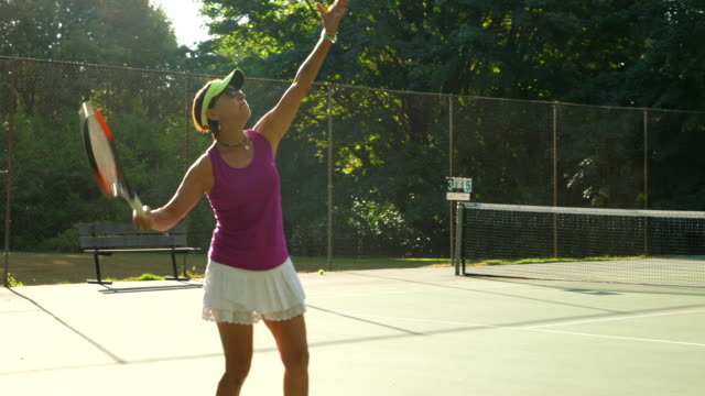 ts senior woman serving while warming up for mixed doubles tennis match - double chance stock videos & royalty-free footage