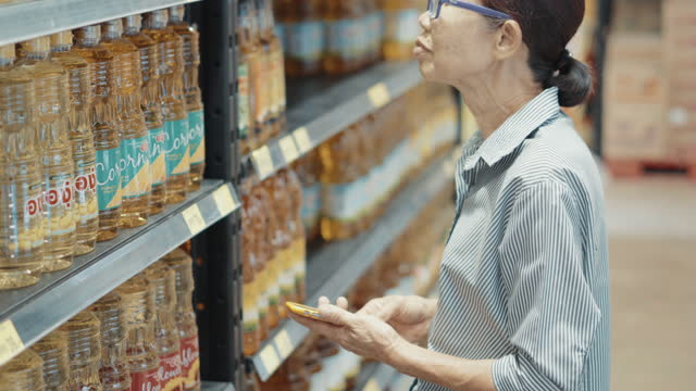 senior woman shopping groceries at supermarket - market retail space stock videos & royalty-free footage