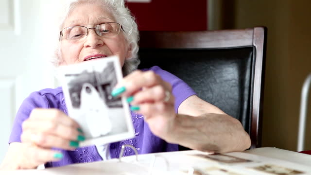 senior woman showing her wedding photo - human face photos stock videos & royalty-free footage