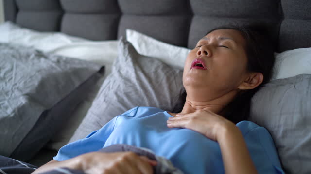 senior woman sick patient coughing in bed - lying on back stock videos & royalty-free footage