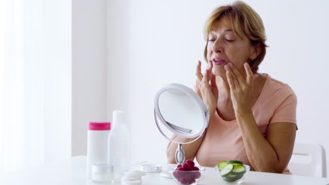 senior woman skin care at home - cucumber stock videos & royalty-free footage