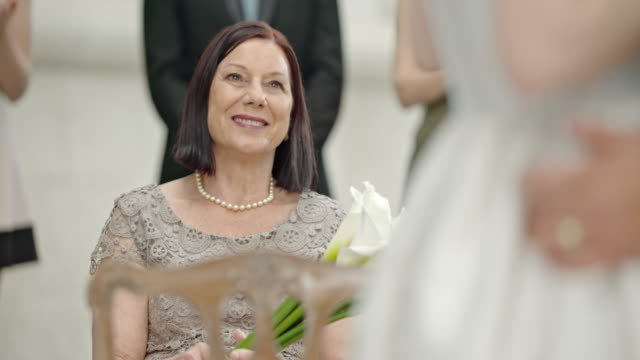 SLO MO Senior woman smiling and applauding at wedding