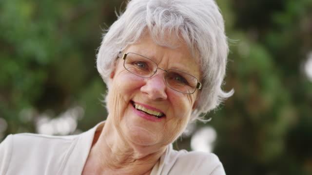 Senior woman smiling and looking at camera