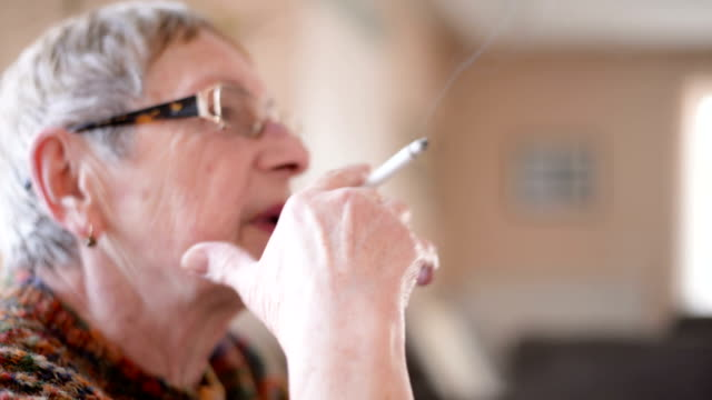 senior woman smoking cigarette - smoking issues stock videos and b-roll footage