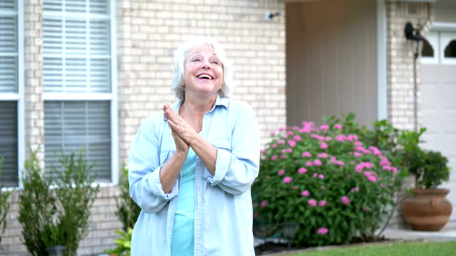senior woman standing in front of home - white hair stock videos & royalty-free footage