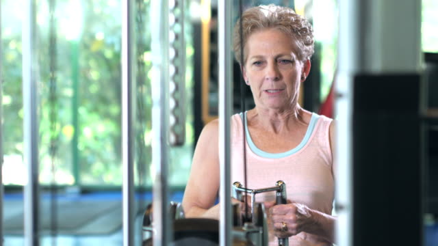 senior woman strength training at the gym - waist up stock videos & royalty-free footage