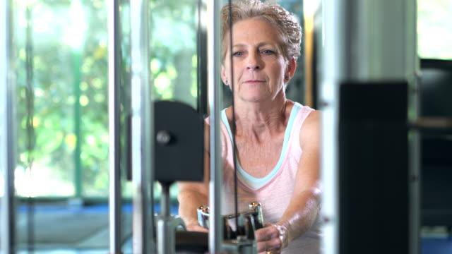 senior woman strength training at the gym - human limb stock videos & royalty-free footage
