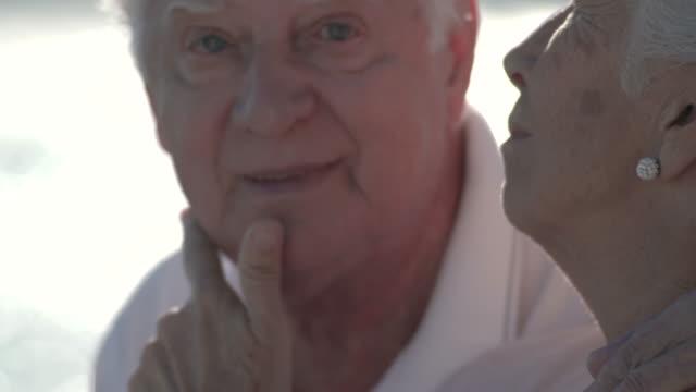 vídeos y material grabado en eventos de stock de senior woman stroking her husband's face and arms with love and affection - cabello canoso